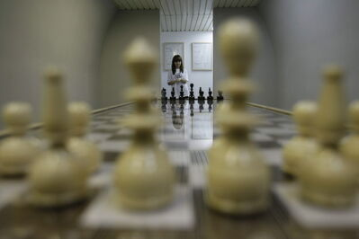 An official explains a chess installation by artist Luchezar Boyadjiev from Sofia, Bulgaria.