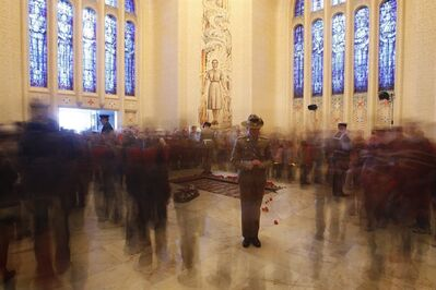 "FILE - In this April 25, 2008 file photo, a soldier stands in the Tomb of the Australian Unknown Soldier as the public file past to leave flowers or pay their respects during the ANZAC Day dawn service at the Australian War Memorial in Canberra, Australia. The Australian War Memorial has reversed a contentious decision to remove ""known unto God"" from the Tomb of the Australian Unknown Soldier after a public outcry. (AP Photo/Rob Griffith, File)"
