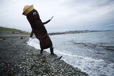 Local sewage activist James Skwarok, also known as Mr. Floatie, dips his boot into the water near Clover Point in Victoria, B.C., on Thursday, Nov. 22, 2012. With the federal byelection in Victoria approaching, Mr. Floatie sees Victoria's lack of sewage treatment emerging as the primary issue and wants Liberals and New Democrats, who traditionally alternate the riding, to remind them what Victorians flush in the the ocean daily. THE CANADIAN PRESS/Chad Hipolito