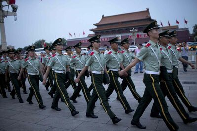 Paramilitary policemen march on Tiananmen Square after a flag-lowering ceremony on Tiananmen Square in Beijing, China, Wednesday. Heavy security blanketed central Beijing on the 25th anniversary of the bloody suppression of the Tiananmen Square pro-democracy protests on Wednesday, pre-empting any attempts to publicly commemorate one of the darkest chapters in recent Chinese history.