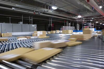 Packages move on a conveyor to be sorted after arriving at a FedEx facility in Toronto on December 5, 2012. The one-day online campaign, which has been running south of the border for five years, is being offered for the second year in Canada and has nearly 250 merchants offering free shipping with delivery guaranteed by Christmas Eve.THE CANADIAN PRESS/Chris Young