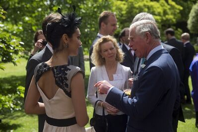 Britain's Prince Charles, right, chats with Tara-Brigitte Bhavnani, left, a Canadian dancer with the Royal Ballet during a reception for Canadians living and working in the UK, at St James's Palace in London, Wednesday, May 14, 2014. Prince Charles and his wife Camilla the Duchess of Cornwall are due to visit Canada from May 18-21, where they will attend events for Victoria Day, the centenary of World War I and the 150th anniversary of the Charlottetown Conference that led to Canadian Confederation. THE CANADIAN PRESS/AP-Matt Dunham, Pool