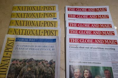 Copies of Canada's national newspapers, the National Post and The Globe and Mail are displayed at a hotel in Burnaby, B.C., on Tuesday January 19, 2016. THE CANADIAN PRESS/Darryl Dyck