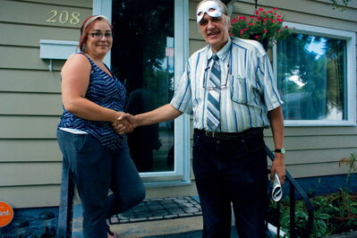 Billet host Tammy Aime shakes hands with Winnipeg Fringe Festival performer Ahti Tolvanen of Thunder Bay outside her Elmwood home. Tolvanen is part of the 11-person production Wealth Secrets.