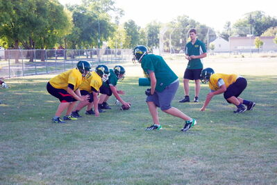 The Miles Macdonell Buckeyes football team practices at the school on Aug. 28.