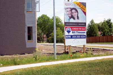 A sign advertises the first phase of the Red Oak Condos. Developer Karl Devlin of Carrington Homes says City of Winnipeg fees for street improvements may affect the planned second phase.