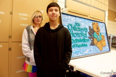John G. Stewart School students Melissa Grantham and Montel McKay helped create two wooden signs to donate to the Children's Hospital Foundation.