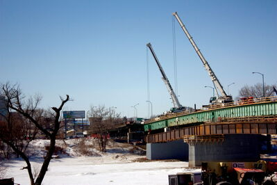 Cranes stand on the Disraeli Bridge as the $195-million project continues.