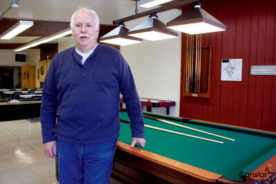 Elmwood East Kildonan Active Living Centre president Con Gislason is shown with one of the centre's two new pool tables.