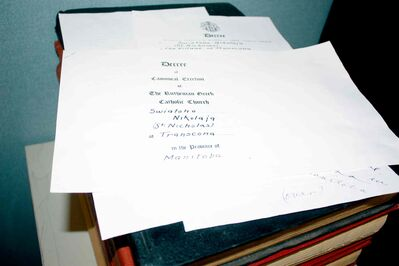 Copies of the documents that helped create St. Nicholas Parish (now known as St. Michael's Ukrainian Catholic Church) are shown.