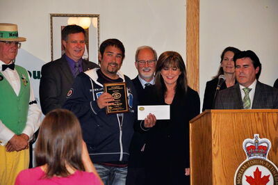 Mike Martel receives his Good Neighbour Award on May 31.