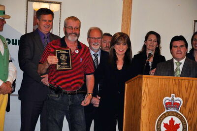 Nick Paley receives his Good Neighbour Award on May 31.