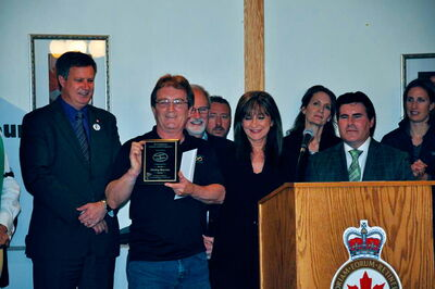Phillip Marion receives his Good Neighbour Award on May 31.