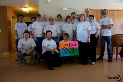 Volunteers who helped repaint L'Arche Dayspring residence at 525 Day St. on April 13 as part of Dulux Paint's Adding Colour to People's Lives initiative are shown.