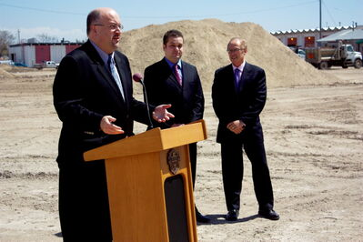 Coun. Russ Wyatt (Transcona) speaks at a press conference announcing the redevelopment of the Public Works yard at 1500 Plessis Rd. into Park City Plaza on May 14 as Coun. Jeff Browaty (North Kildonan) and Mayor Sam Katz look on. The site will host residential and recreational developments.