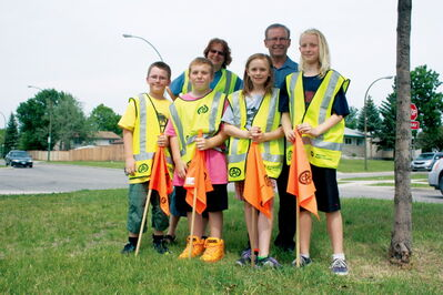Adult crossing guard Kathy Mitchell and Bernie Wolfe Community School principal Andy Zarrillo are shown with patrols Kadin Friesen, Daniel Peters, Lexie Desjarlais, and Nicole Harder at the corner of Bournais Drive and Rougeau Avenue near the school. The intersection is expected to see more traffic when the Plessis Road CN crossing closes for 18 months beginning in July in order to construct an underpass.