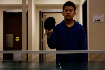 East Kildonan table tennis player Euwe Makinano is shown with his paddle at Sinclair Park Community Centre.