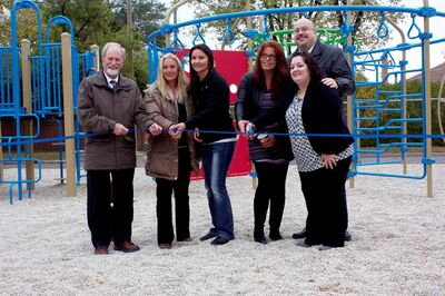 Transcona MLA Daryl Reid, St. Joseph the Worker School parents Louise Hedman, Tamara Sanford, and Nicole Lindell, principal Judi Pacheco, and Transcona Coun. Russ Wyatt are shown at a ribbon cutting for the school's new play structure on Oct. 4.