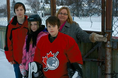 Thomas, Mandy, Samuel and Kelly Livingstone show the lock preventing children from skating at the Clara Hughes Recreation Centre at approximately 4:45 p.m. on Jan. 8.