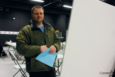 Elmwood resident Jason Neiser peruses some information at the Elmwood Community Recreation Review open house at Elmwood High School on Jan. 31.