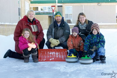 Westview School principal Karla Gould, physical education teacher Dale Fust and parent council chairperson Crystal Honey show off the school's developing curling rink along with students Kamea Mulholland, Parker Honey, and Cadon Honey.