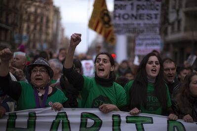Protesters shout slogans against evictions as they march along a street during a demonstration in Barcelona Spain, Saturday, Feb. 16, 2013. Demonstrations are being held across Spain to protest harsh repossession laws that have led to hundreds of thousands of evictions during the country's deep recession. More than 350,000 Spaniards have received eviction orders since 2008 because they were unable to make mortgage payments. (AP Photo/Emilio Morenatti)