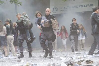 From left, Sam Braddock (David Paetkau), Ed Lane (Hugh Dillon) and Jules Callaghan (Amy Jo Johnson) rescue children from a bombed-out daycare in the series finale.