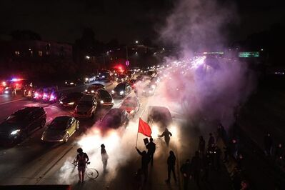 Protesters march along Interstate 580 in Oakland, Calif., Saturday, Aug. 12, 2017. Protesters marched in Oakland to decry racism in the wake of deadly violence that erupted at a white nationalist demonstration in Virginia. (AP Photo/Noah Berger)