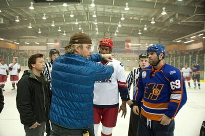 Director Michael Dowse with the cast on the set of Goon.