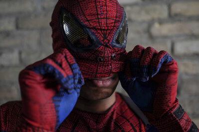Gregory Marrast has been dressing up as Spiderman, Iron Man, Optimus Prime and Elmo for four years - for parties, summer festivals, the Ex, you name it.
