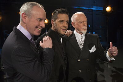 George Stroumboulopoulos (centre) poses for pictures with Hockey Night in Canada's  Ron MacLean (left) and Don Cherry.