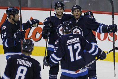 Shortly after killing a five-on-three situation, Jets left-winger Evander Kane (right) scored what proved to be the winning goal against the Devils on Sunday.
