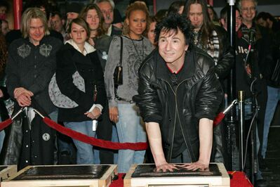 Terry Bozzio puts his hands into cement during an induction ceremony into Hollywood's RockWalk in 2006. Bozzio will perform in Winnipeg this October.