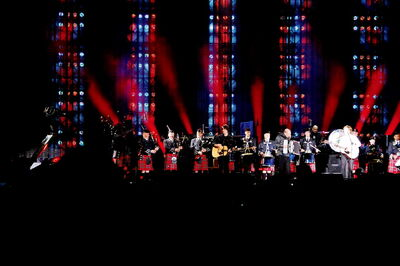 The Winnipeg Police Pipe Band performs with SIr Paul McCartney at Investors Group Field on Aug. 12.