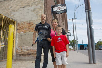 Harbour View South resident Markus Deutsch (left) is planning an eight-hour tennis marathon in support of Siloam Mission on Sept. 7. Also pictured are Siloam director of resource development Judy Richichi and Deutsch's eight-year-old son Josiah.