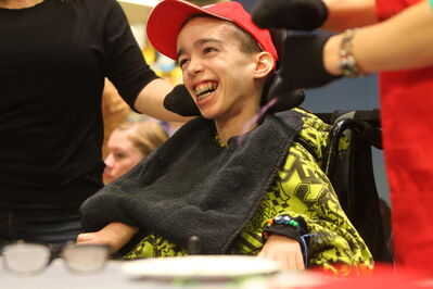 Nineteen year old Mitchell Potter is all smiles after showing off his beadwork he made while taking part in kickoff of Safeway's annual fundraising campaign.