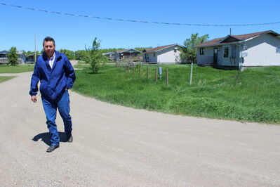 Chief Vince Tacan walks along a residential street in Sioux Valley Dakota Nation.