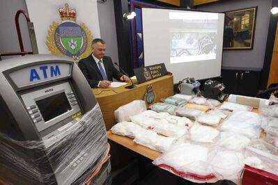 Staff Sgt. Rob Harding with a sample of items seized.