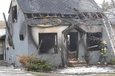 Patrolling police officers noticed the burning home on Cheriton Avenue first about 4 a.m. and called it in.