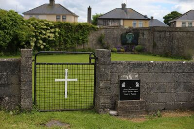 The site of a mass grave for children who died in the Tuam mother and baby home, in Tuam County Galway Wednesday June 4, 2014. The Catholic Church in Ireland is facing fresh accusations of child neglect after a researcher found records for 796 young children believed to be buried in a mass grave beside a former orphanage for the children of unwed mothers. The researcher, Catherine Corless, says her discovery of child death records at the Catholic nun-run home in Tuam, County Galway, suggests that a former septic tank filled with bones is the final resting place for most, if not all, of the children. County Galway death records showed that the children, mostly babies and toddlers, died often of sickness or disease in the orphanage during the 35 years it operated from 1926 to 1961.