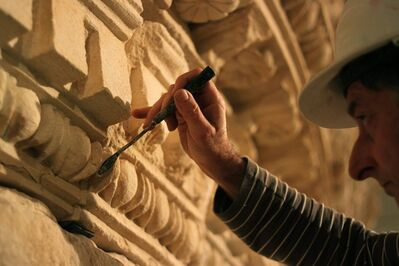 A restorer at the Israel Museum works on a reassembled display of what curators say was Herod's tomb in the Israeli museum, Jerusalem, Tuesday, Jan. 15, 2012. Israel's national museum is opening the world's first exhibition on King Herod, displaying what it says are the reconstructed tomb and sarcophagus of one of antiquity's most towering and despised figures. Palestinians object to the exhibit because it displays artifacts from West Bank sites. Archaeology official Hamdan Taha says the project was not coordinated with the Palestinians, and is against international law. The museum says it will return the antiquities when the exhibit closes in 9 months. (AP Photo/Daniel Estrin)