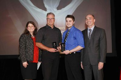 (From left) Calm Air vice-president Sandra Ross, Team Matt Dunstone coach Scott Grant, curler Matt Dunstone and Sport Manitoba chair Jeff Palamar. Dunstone was presented with Calm Air Junior Team of the Year at Sport Manitoba's Night of Champions on April 28.