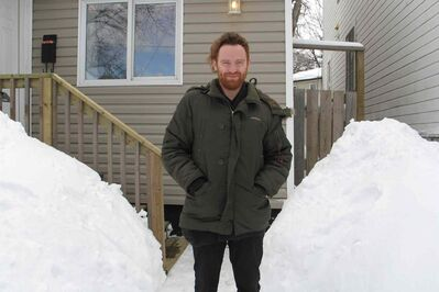Matt Peters of Royal Canoe outside his Point Douglas home. Royal Canoe is nominated for Alternative Album of the Year at the 2014 Juno Awards in Winnipeg.
