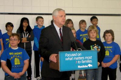 Minister of Conservation and Water Stewardship Gord Mackintosh and Belmont School students at the announcement of a new kindergarten to Grade 5 French immersion school in the Riverbend area.