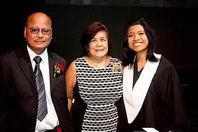 (Left to right) Maricel's parents Reynaldo and Florencia Lisan with Wandaly Gonzales at Maples Collegiate's convocation ceremony.