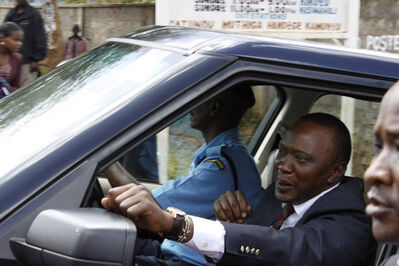 Kenya's President-elect Uhuru Kenyatta, right, is driven away after attending a church service at the Catholic church in his hometown of Gatundu, about 45 kilometres north of Nairobi, Kenya, on Sunday.