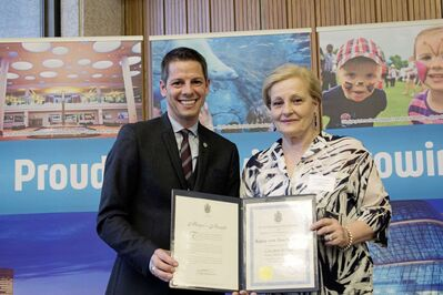 Katia von Stackelberg, executive director of the Corydon Business Improvement Zone (BIZ) receives an award from Mayor Brian Bowman.