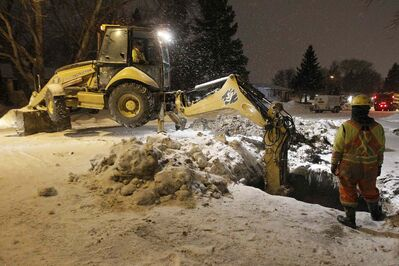 A crew works on a water-main break on Laxdal Road on Jan. 19.