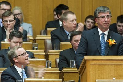 Saskatchewan Premier Brad Wall, left, applauds as Saskatchewan Finance Minister Ken Krawetz tables the 2013 Provincial Budget in Regina on Wednesday, March 20, 2012. THE CANADIAN PRESS/Liam Richards