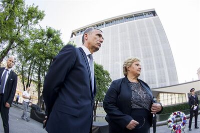 "Jens Stoltenberg, Secretary General of NATO, left, and Norwegian Prime Minister Erna Solberg, attend a wreath laying ceremony near the damaged government building in Oslo Tuesday, July 22, 2014, to mark the third anniversary of twin attacks that killed 77 people in Oslo and on Utoeya Island, on July 22, 2011. Solberg said the best way to honor the 77 people who died in terror attacks three years ago is to ""fight for openness, tolerance and diversity,"" and that ""violent extremism can never be excused."" (AP Photo/NTB Scanpix, Vegard Grott) NORWAY OUT"
